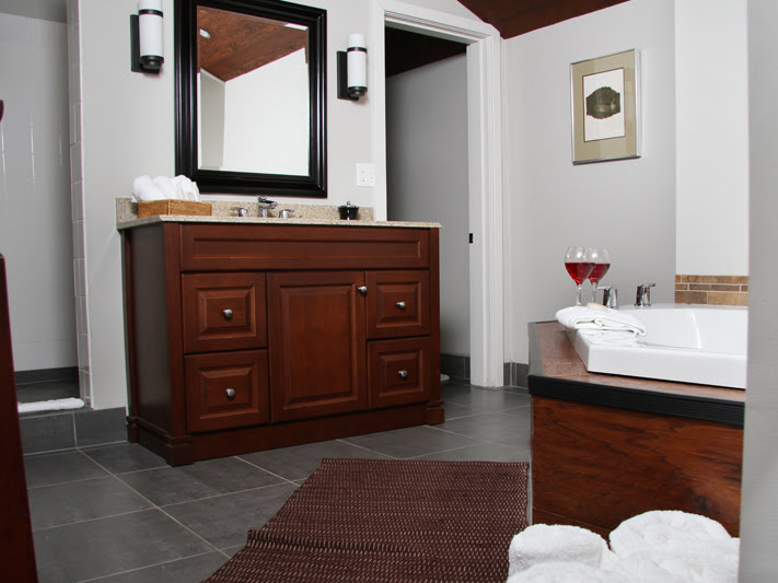 The Kaizen Bathroom features an oversized whirpool tub and waterfall shower for two