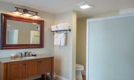 McCully King walk-in waterfall shower and large vanity